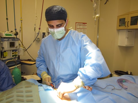 Dr. Zoumalan is harvesting fat from the patient's abdomen. The fat will then be prepared and injected along the periorbital and other facial regions.